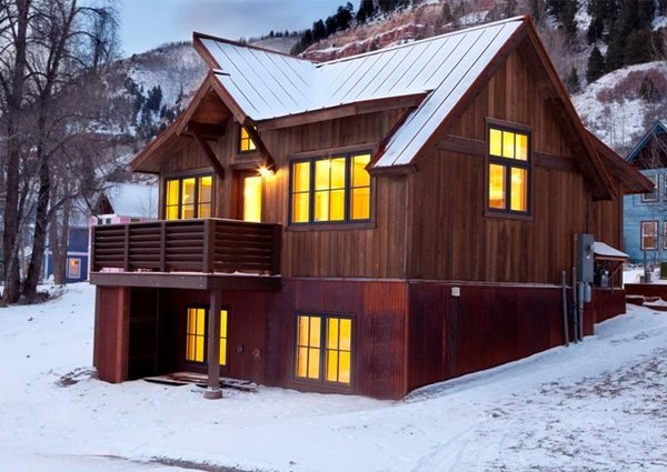 Based in Poncha Springs, Colorado, Great Western Homes designs and builds a range of homes that have a modern, rustic edge. By mixing materials -- wood, weathered steel, and a standing seam metal roof, this residence is a modern take on a classic cabin, with steeply pitched roofs for shedding snow.