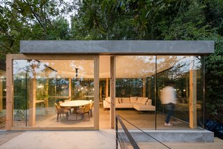 A Portuguese Glass House Uses Surrounding Foliage as a Privacy Screen - Photo 5 of 15 - Some of the large planes of glass are sliding doors that open to the environment.