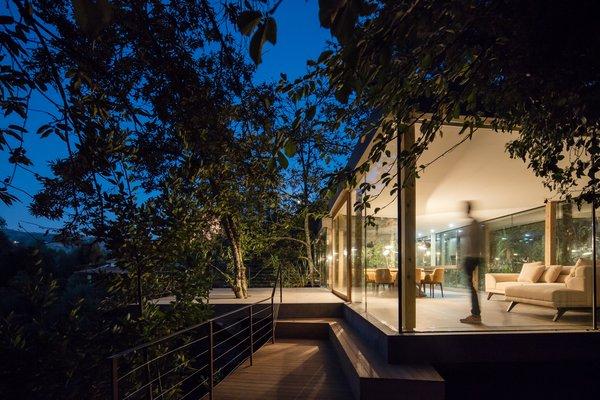 At night, the home glows like a glass jewel box.