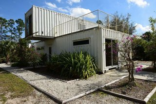6 Weather-Ready Prefab Homes in Florida - Photo 2 of 6 - Functioning as a vacation rental for tourists, entrepreneur Rick Clegg combined old shipping containers to create a four-bedroom home with an eco twist near Palm Beach, Florida. Because of the container's inherent durability, they meet Florida's stringent construction standards. The compactness of the home; its low carbon footprint because of the use of the recycled, prefabricated containers; and the home's proximity to the Loxahatchee River make it ideal for ecotourists.