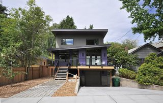 These 8 Prefabs in Seattle Make Us Want to Move to the Emerald City - Photo 3 of 8 - Inspired by the traditional shingle-clad homes in the neighborhood, this prefab was based off a design by Method Homes and then customized by Grouparchitect to accommodate the client's needs, as well as the unique site. Doors were widened, a rear porch was enclosed for an additional bedroom, and specialized storage was added, including an enlarged laundry room, a generous pantry, and built-in cubbies for each member of the family.