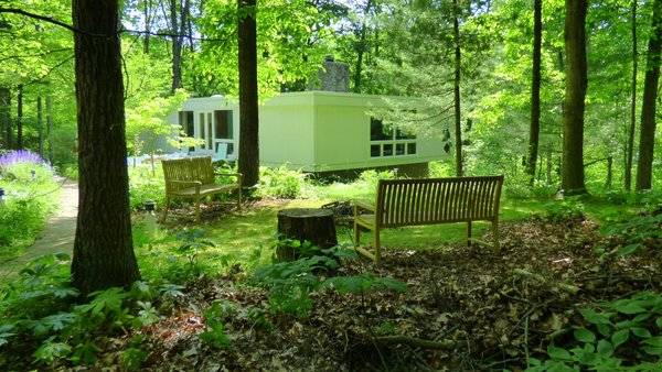 Outdoor campfire area.  Most of the trees around the home are about 100 years old.   Photo 3 of Phelps Residence modern home