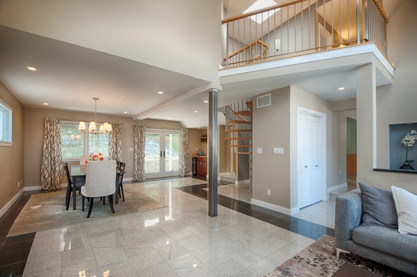 Dramatic living/dining with french doors leading right outside to garden oasis Photo  of Medford Oasis modern home