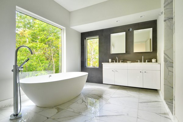 Master bathroom Photo  of Oyster Shores modern home