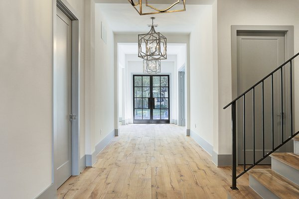 Large entry way hall with gorgeous iron front doors.  Photo 2 of Braes Heights Home- Merrick modern home