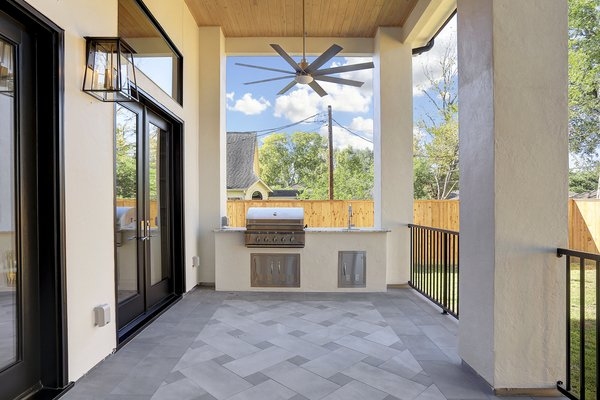 Outdoor Kitchen area on the covered patio.  Photo  of Braes Heights Home- Merrick modern home