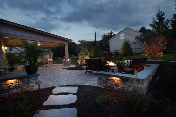 We continued the patio beyond the roofline for a more open feel and added a natural gas fire pit and seating walls as an entertainment focal point. Photo 3 of The Stitt Residence modern home