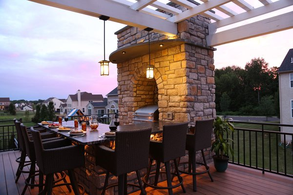 The accent lighting in the outdoor kitchen sets the perfect mood for evening dining. Photo 5 of The Nowak Residence modern home
