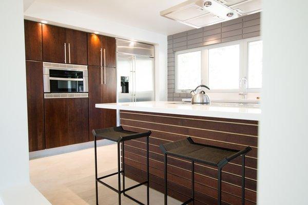 Custom Kitchen: Solid Cherry Casework, Quartz Countertops + Polished Concrete Floors Photo 12 of Edgewood modern home