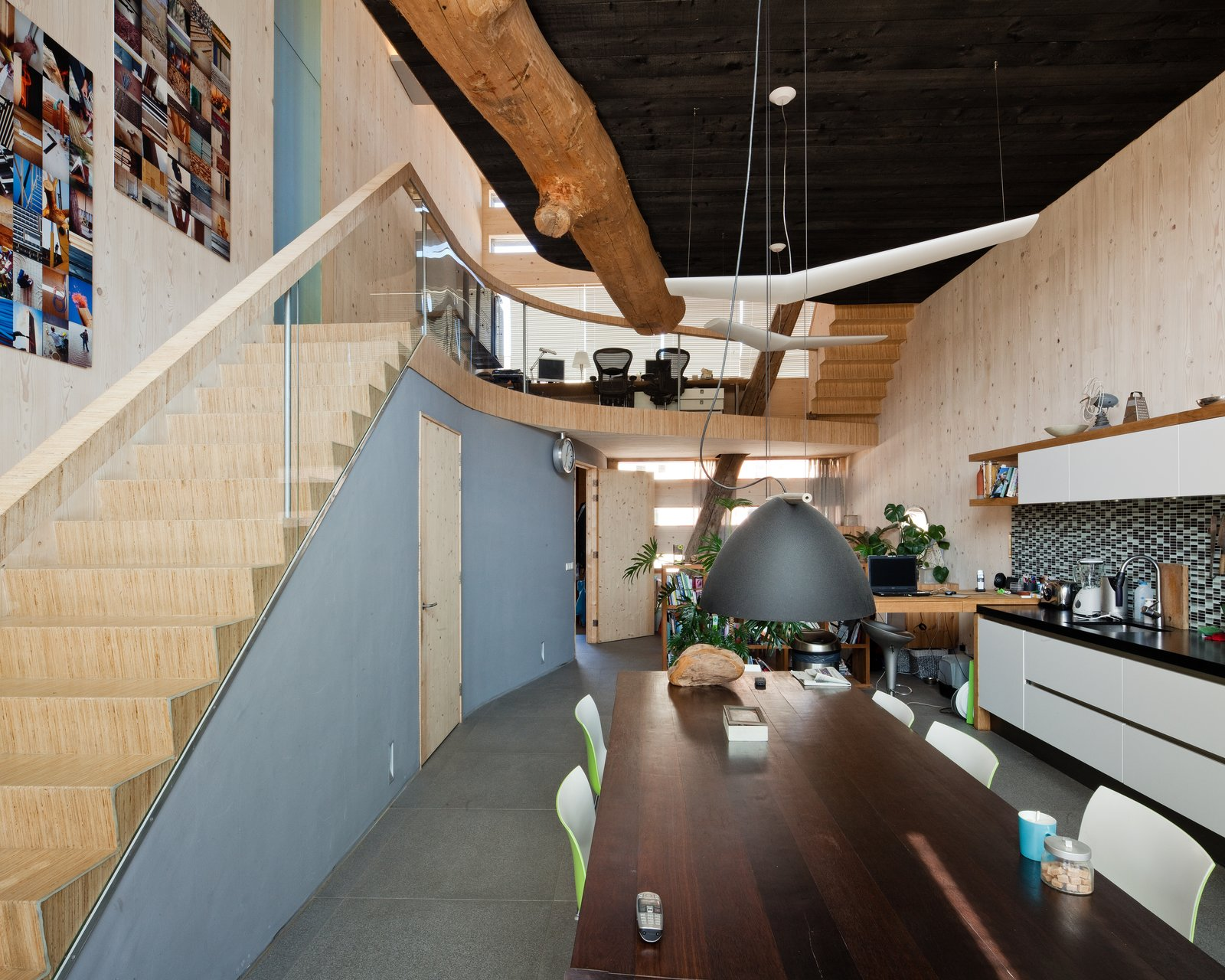 The dining and kitchen area are located on the first floor. The ceramic tile floor is from a local source, which is Cradle to Cradle certified.