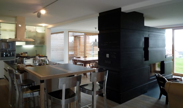Kitchen with the dining area and the fireplace Photo 12 of Wood House modern home