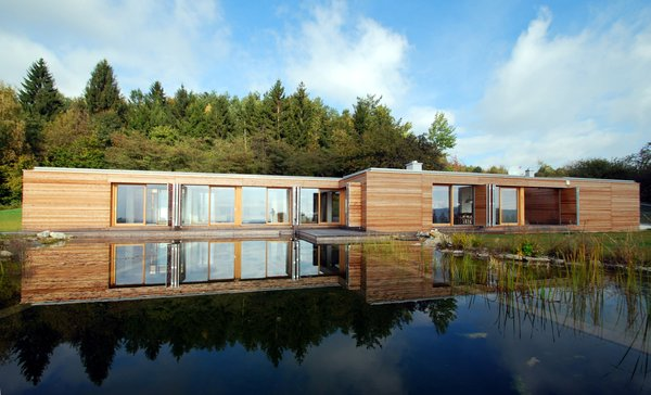 View over the swimming pond Photo 6 of Wood House modern home