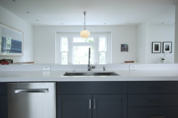 Two inch slab engineered quartz countertops are solid matte white. Photo 14 of Golden Gate Park Residence modern home