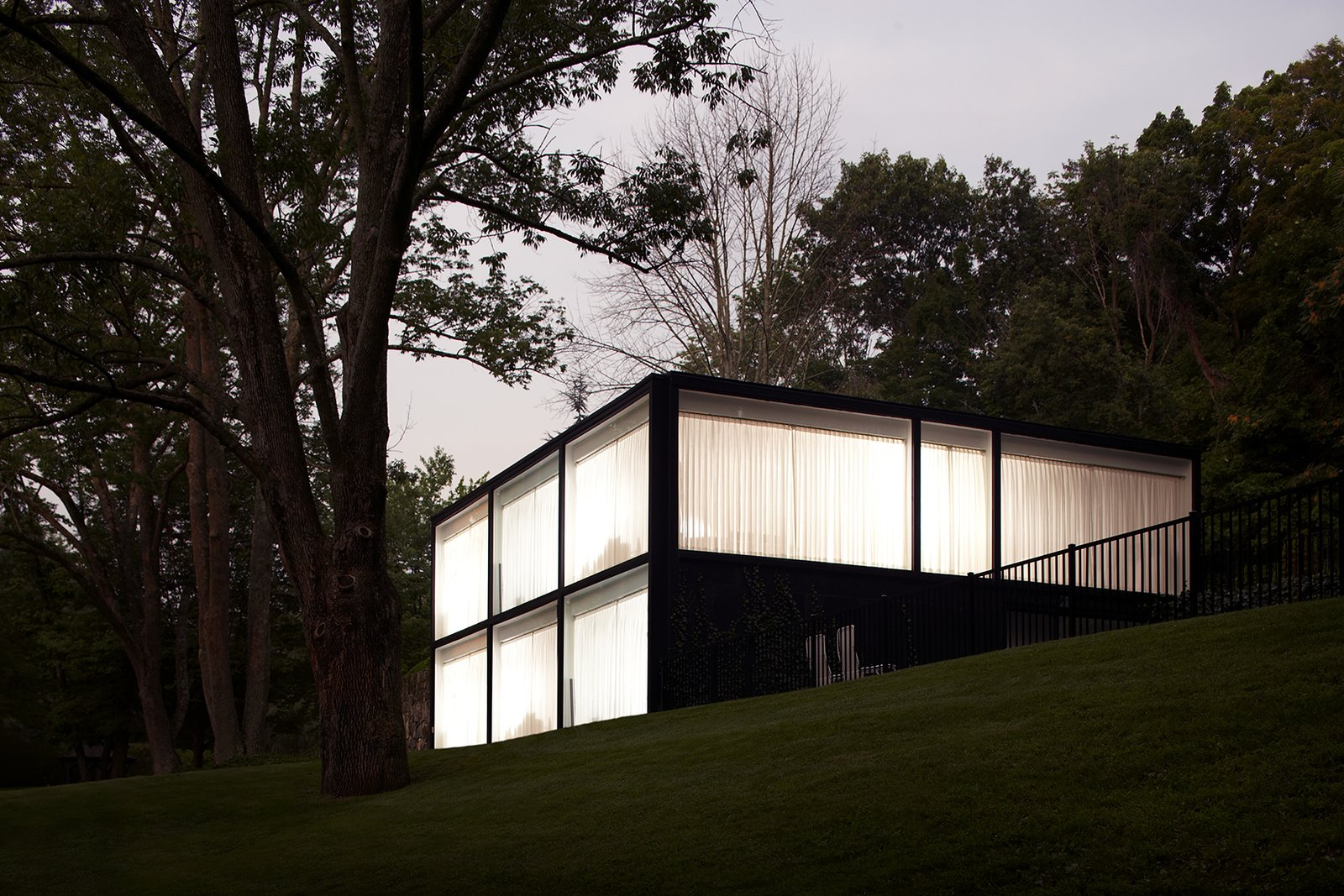 Exterior at dusk.  Glass House by T Seisser