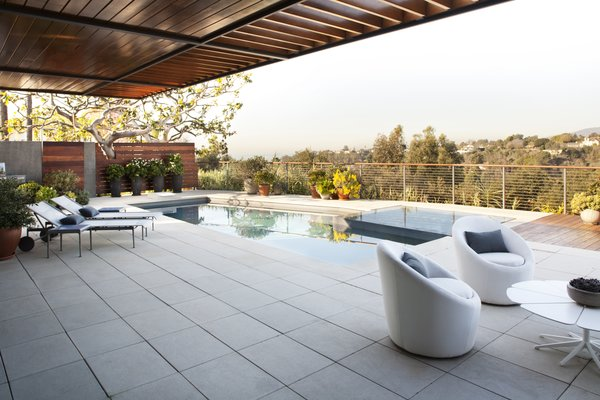 The outdoor furniture is a combination of Room and Board Oasis Collection  and Knoll 1966 Line using Sunbrella Photo  of Adelaide House modern home