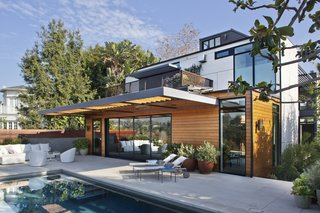 "These 11 Modern Homes in Southern California Offer an Indoor/Outdoor Lifestyle - Photo 3 of 11 - From the Interior Designer: ""The indoor/outdoor aspect of California living was inherent in the siting and architecture of this Santa Monica home. The furniture plan placed a premium on providing ample opportunities for the house's inhabitants to contemplate the picturesque landscape. The outdoor furniture is a combination of the Oasis Collection by Room and Board and Knoll's 1966 Line that uses Sunbrella Fabrics. A rare planter by Artist Willy Guhl and a Michael Smolcich planter adorn the pool deck."""