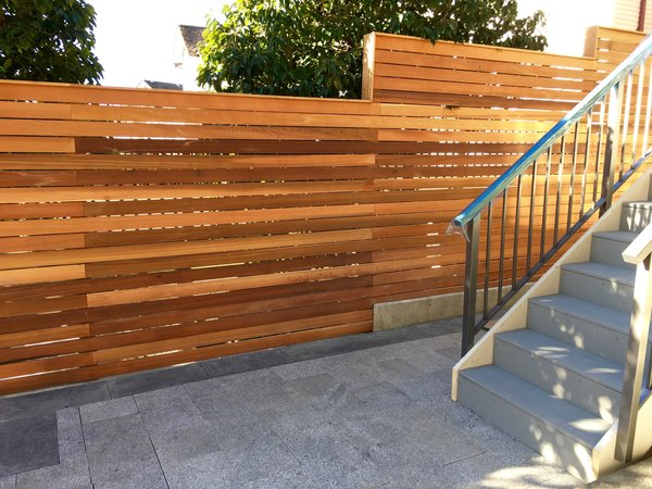 Cedar privacy screen fence and stone paver patio & path Photo 4 of Port Moody Makeover modern home