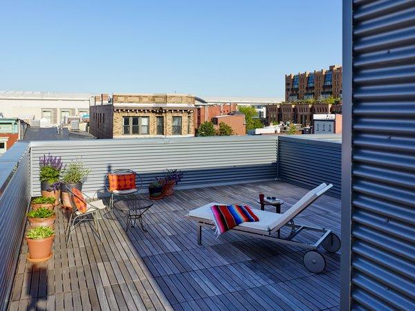 Ipe decking on the rooftop terrace with views of the National Mall. Photo  of 10th Street Duplexes modern home