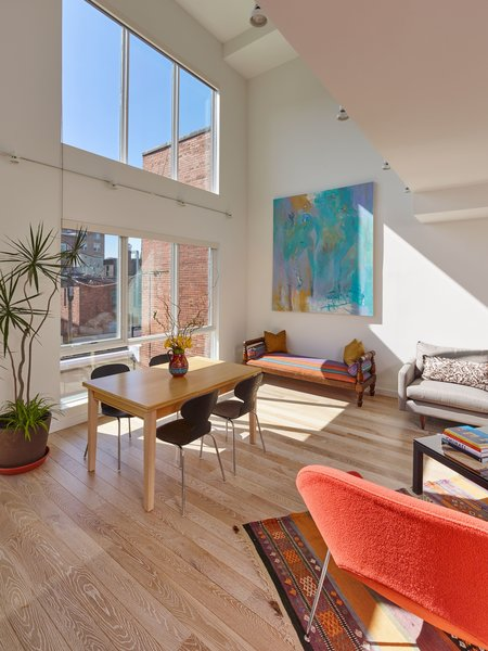 Double-height living space provides an abundance of natural light and enables cross ventilation. Photo 2 of 10th Street Duplexes modern home