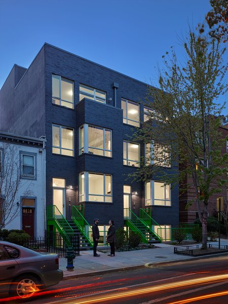 View of exterior at dusk. Photo 8 of 10th Street Duplexes modern home
