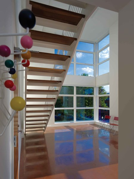 Double-height living space and open riser stair. Photo 3 of Bailey Lofts modern home
