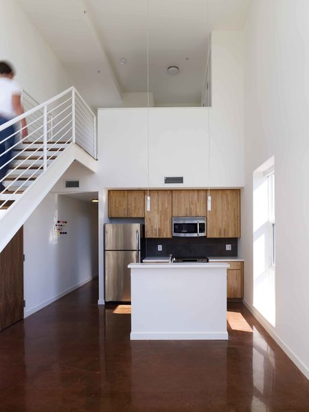 Kitchen with mezzanine above Photo 4 of Bailey Lofts modern home