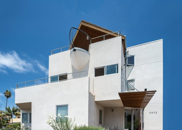 Three stories of ocean views, and a unique boat-bow balcony offers a bit of humor to this beachy neighborhood. Photo 4 of The Beach House modern home