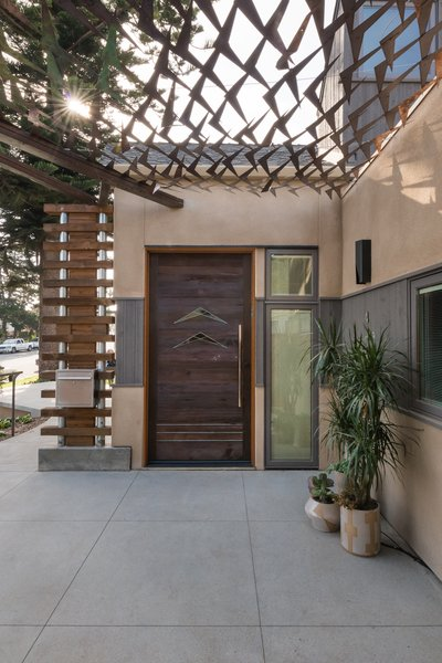 Custom copper canopy shades the exterior entry and adds a pop of color as the material oxidizes to a textured turquoise. Photo 3 of The Modern Mission modern home