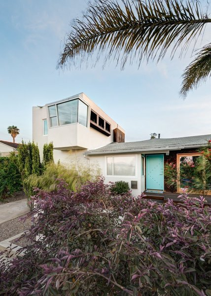 The single story space shows the original shape of the home and what was upgraded in the first remodel. The two story add on created space for children's rooms and a home office with a view. Photo  of The Ranch House modern home