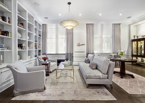 Modern home with living room, coffee tables, bookcase, sofa, ottomans, ceiling lighting, accent lighting, and medium hardwood floor. Photo 3 of Renovated Brownstone Living