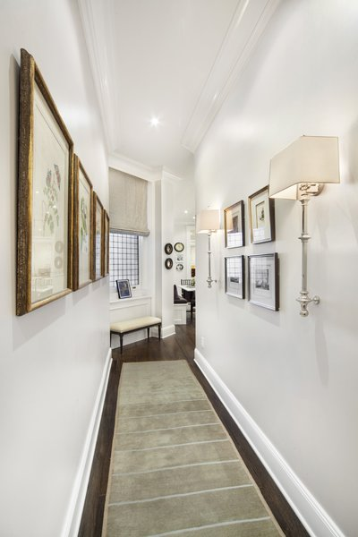 Modern home with hallway and medium hardwood floor. Photo 4 of Renovated Brownstone Living