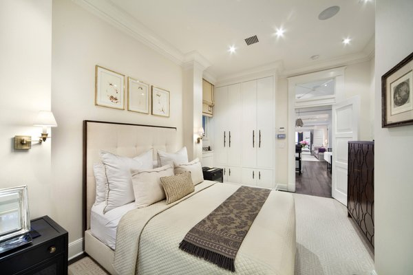 Modern home with bedroom, bed, night stands, dresser, storage, wardrobe, accent lighting, and carpet floor. Photo 5 of Renovated Brownstone Living