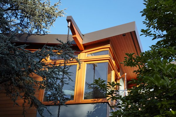 The dynamic butterfly roof and rain chains add to the modern look Photo 2 of The Gravity House modern home