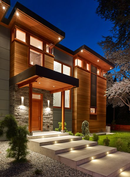 The welcoming exterior front walkway lights up at night Photo 3 of The Gravity House modern home