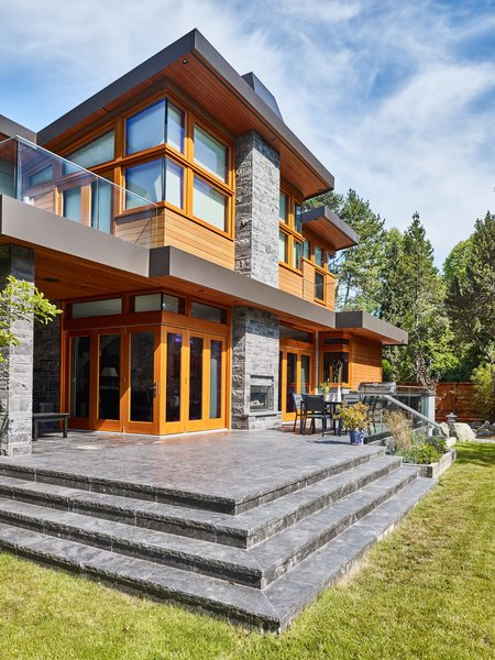 Luxurious top quality stone, wood and glass come together to provide an spacious and elegant back yard presence Photo 9 of The Gravity House modern home