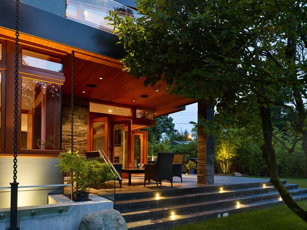 Elegant evening view of stunning back corner deck Photo 6 of The Gravity House modern home
