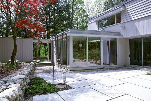 The new addition alongside the redesigned patio and garden. Photo 4 of Giese House modern home