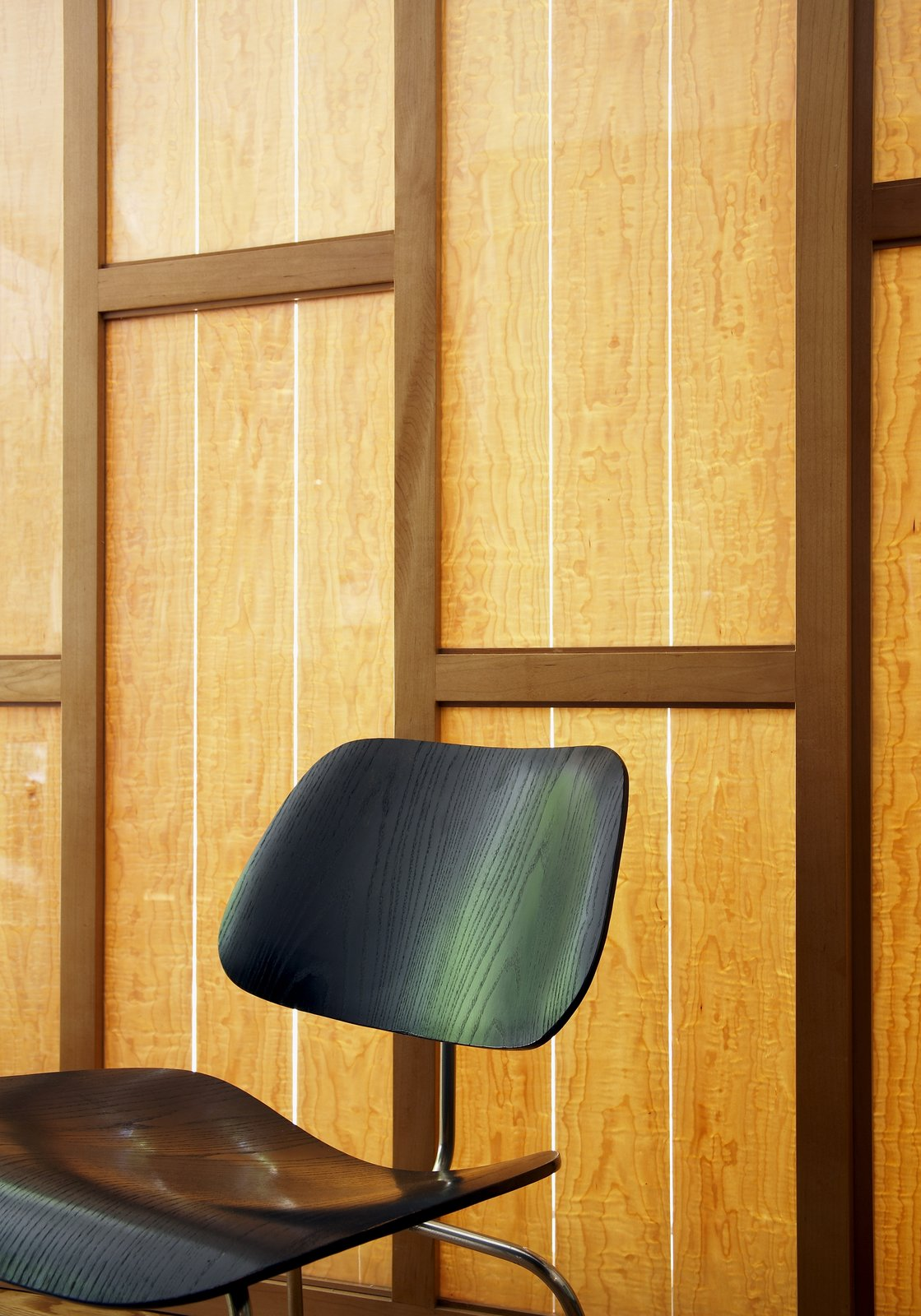 Eames' chair in front of our custom sunscreen with maple veneer.