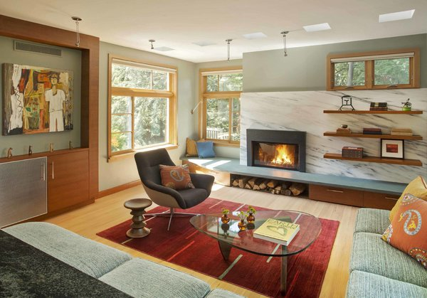 The living room, with a Vermont marble slab at the fireplace wall. Photo 8 of Sustainable Urban Villa modern home