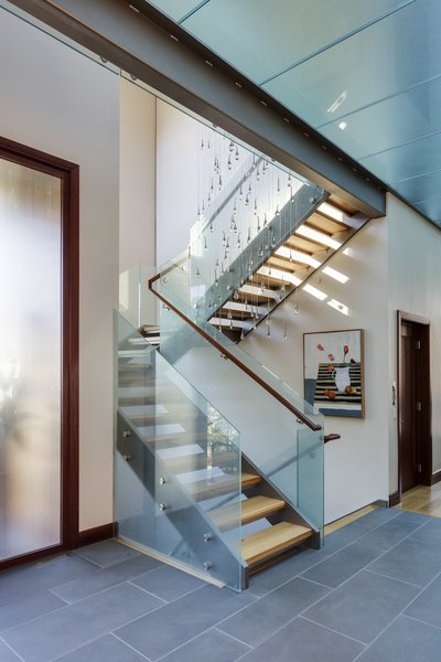 custom Ochre light at open stairs Photo  of Boston Suburbs modern home