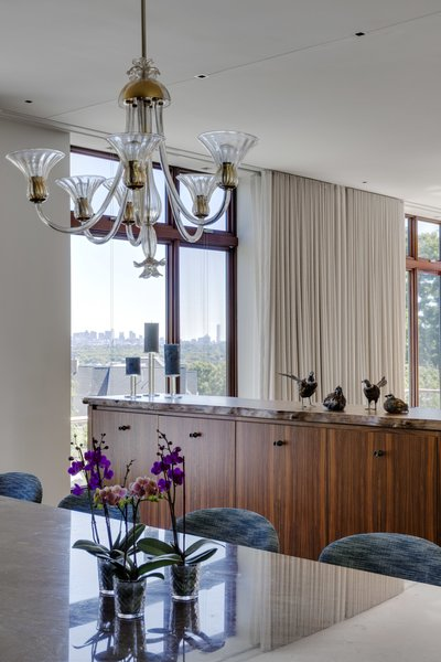 Dining Room overlooking live edge millwork separating Living Room area Photo 8 of Boston Suburbs modern home