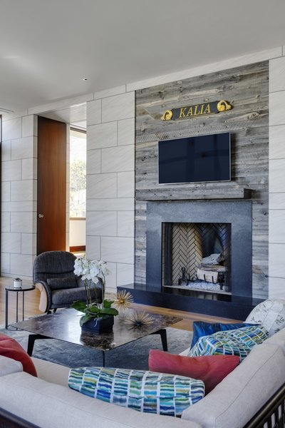 reclaimed wood surround at fireplace Photo 15 of Boston Suburbs modern home