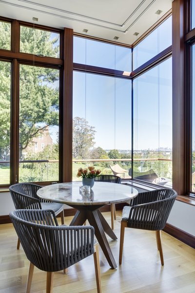 corner window view out to Boston at breakfast table Photo 17 of Boston Suburbs modern home