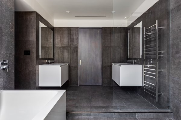 Modern home with bath room, undermount sink, freestanding tub, soaking tub, cement tile floor, open shower, and ceiling lighting. Master Bathroom - White thermafoil floating vanities, Duravit and Hansgrohe fixtures, Large-format Italian porcelain tile from Emil Ceramica Photo 7 of Castro Residence