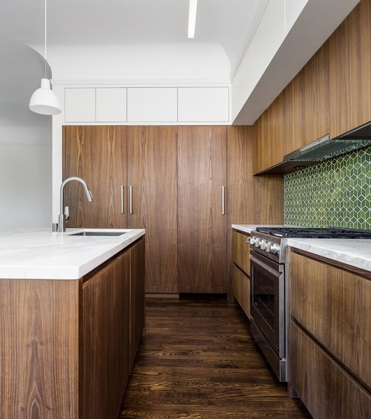 Kitchen - European fumed chestnut cabinetry, featuring quarter-sawn, sequenced veneers and an oiled finish, Miele appliances, Heath tile backsplash, Calacatta countertops, Louis Poulsen pendant lights