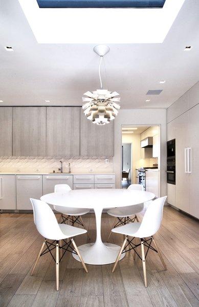 Breakfast Room - Saarinen Tulip Table, Eames side chairs, Miele appliances, Louis Poulsen PH Stainless Steel Artichoke light Photo 14 of Lyon Residence modern home