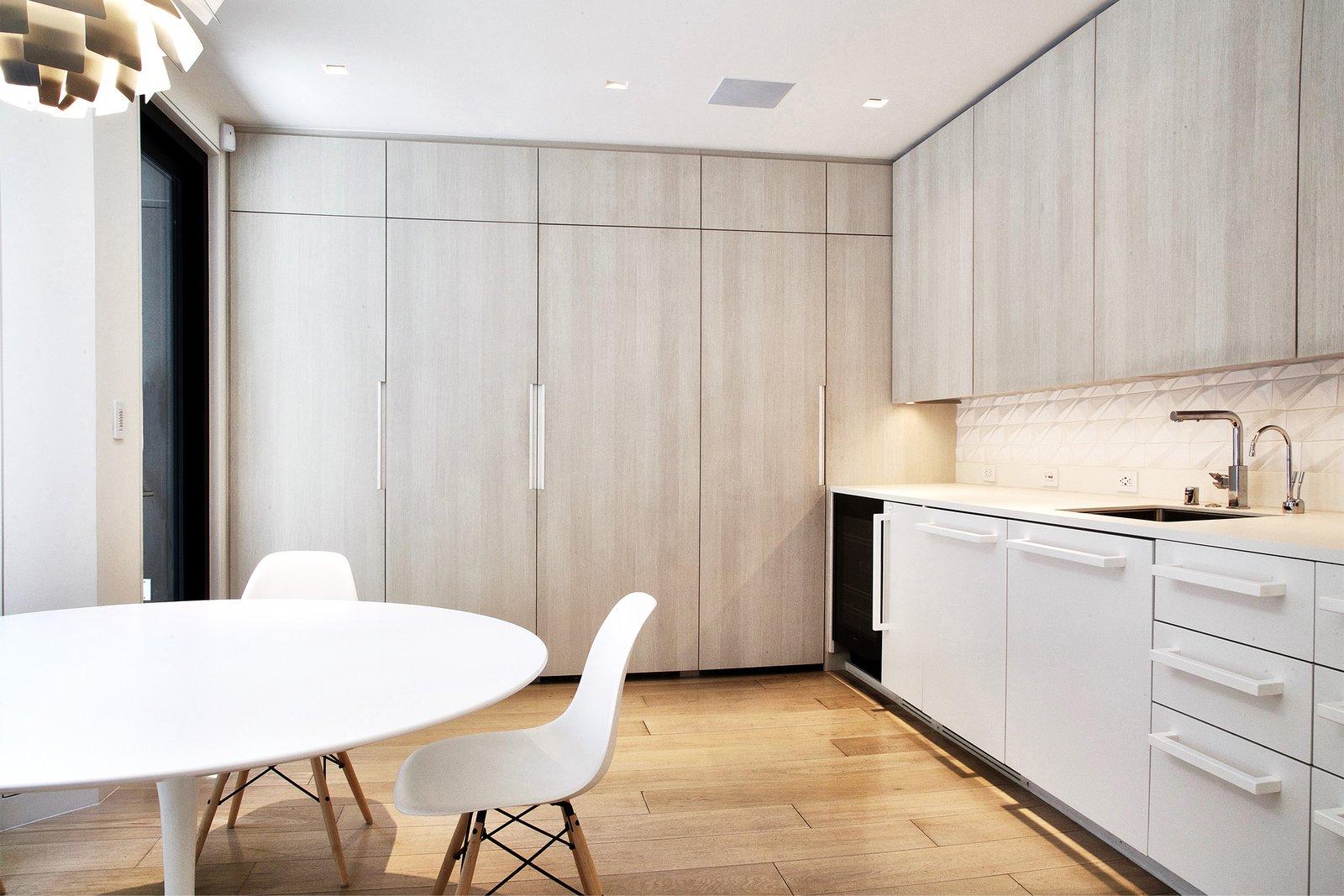 Breakfast Room - Saarinen Tulip Table, Eames side chairs, Miele appliances, Louis Poulsen PH Stainless Steel Artichoke light
