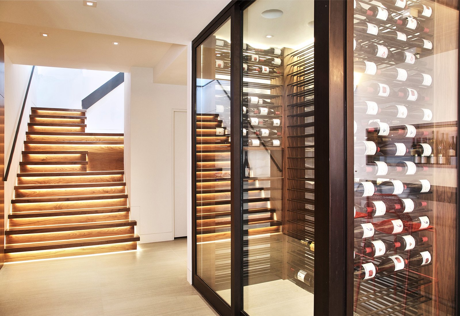 Stairs + Wine Room Tagged: Staircase, Wood Tread, Wood Railing, and Glass Railing.  Lyon Residence by Diego Pacheco Design Practice
