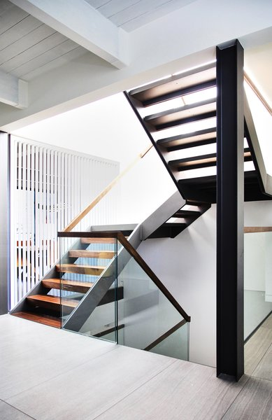 Modern home with staircase, wood tread, wood railing, and glass railing. Walnut and Steel stair connecting all floors Photo 2 of Lyon Residence