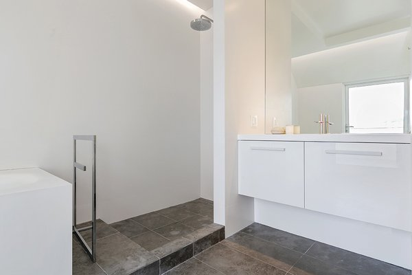 Master Bathroom, with Santini plumbing fixtures & Lacava solid surface soaking bathtub Photo 11 of Coleridge Residence modern home